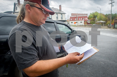 Robert Layman / Staff Photo Henry Allen shows off signatures from a petition he created that is trying to keep a full service Mobil station from going out of business he was one employed at in downtown Brandon, October 9, 2017. Allen lost his position at the station after creating the petition and asking people to sign it while they stopped to get fuel.