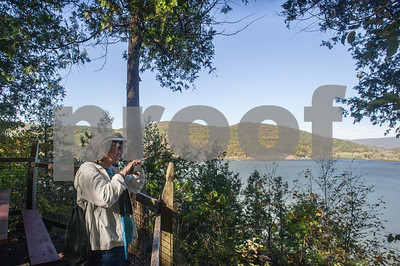 Robert Layman / Staff Photo The Thursday Hikers, a group that meets in Rutland and travels to various parts around the Rutland region, celebrated their final hike of the season at Mt. Independence in Orwell, Thursday, October 19, 2017. Seen here, Kathy Drew, front, stands with Bob Perkins as they overlook Lake Champlain.