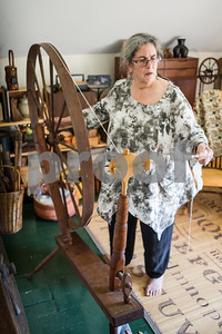 Robert Layman / Staff Photo Nora Rubinstein spins fiber on a wheel she believes to be crafted by Samuel Morison in the 1800s at her home in Middletown Springs Thursday afternoon.