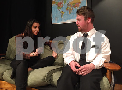 Robert Layman / Staff Photo Ellie, left, played by Maya G. Redington, tries to convince Elder Thomas, played by Eric Ray to take a hit of a vaporizer filled with marijuana.