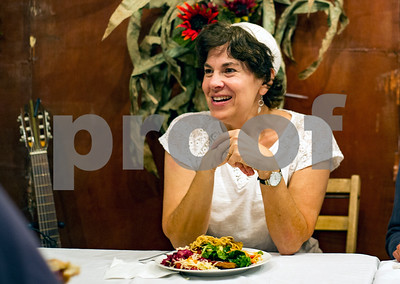 Robert Layman / Staff Photo  Rabba Kaya Stern-Kaufman enjoys dinner during Sukkot, a Jewish holiday that celebrates the harvest, at the Rutland Jewish Center in Rutland, October 5, 2017. Hosting Sukkot was Stern-Kaufman's first public event at the center.