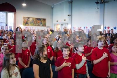 Robert Layman / Staff Photo  Children recite the pledge of allegiance during the Rutland Intermediate School Veteran's Day ceremony Thursday, November 9, 2017.