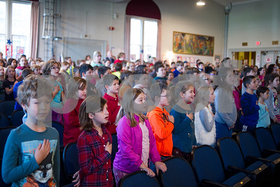 Robert Layman / Staff Photo Students recite the pledge of allegiance during the Rutland Intermediate School Veteran's Day ceremony Thursday, November 9, 2017.