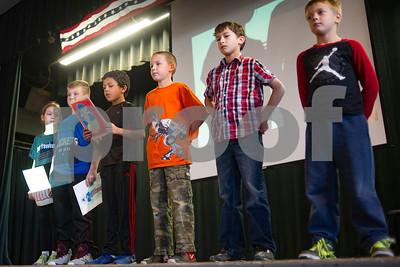 Robert Layman / Staff Photo Students give a presentation during the Rutland Intermediate School Veteran's Day ceremony Thursday, November 9, 2017.