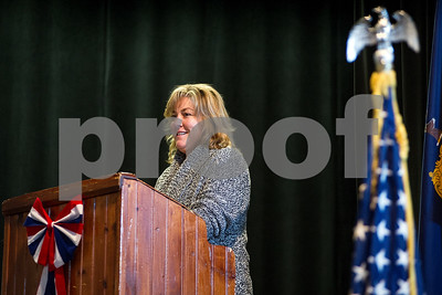 """Robert Layman / Staff Photo Mrs. Larna Poljacik, third grade teacher at Rutland Intermediate School and former aircraft mechanic in the US Navy, adresses students during the school's Veteran's Day assembly in the theater Thursday November, 19, 2017.Poljacik adressed the students about her service, which stationed her in Norfolk, V.A. """"I washed pans I could hide in,"""" she said. Poljacik went on to say that through her service, she was able to attend college through the G.I. Bill to become a teacher."""