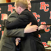 """Dr. David Greer awards Johnathon Hogan with """"The Leo"""" for Excellence in History Studies."""