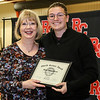 Dr. Carol Cooper awards Skye Donaldson a Shield Service award. Skye also received the Outstanding Mass Communication Student award.
