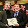 "Dr. David Greer awards Johnathon Hogan ""The Leo"" for excellence in history studies."