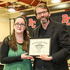 Professor Zachary Watson presents Outstanding English Student to Michal Smelser.