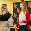 Dr. Anne Nichols recognizes a member of the Alpha Chi International Honor Society.