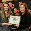 Professor Katherine Stokes awards Christy Routheaux the Outstanding Business Student of the Year award.