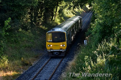 2801 + 2802 amble past Lisheenacloonta, south of Nenagh with the 0745 Nenagh - Limerick Commuter service. Mon 17.07.17
