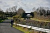 Finnyus walking to the road bridge to get his photo at Commons. Gowran Level Crossing (XW069) can just be seen in the distance. Sun 05.11.17