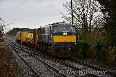 076 ambles through Portlaoise with a 1030 Heuston - Mallow Sperry Train movement. The Sperry wagon (third wagon back) is used for ultrasonic testing of the rail. Tues 14.11.17