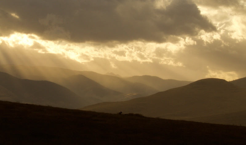Storm clouds and sunlight over Montana foothills