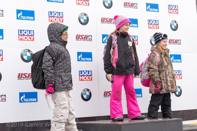 Schoolchildren on the medal podium