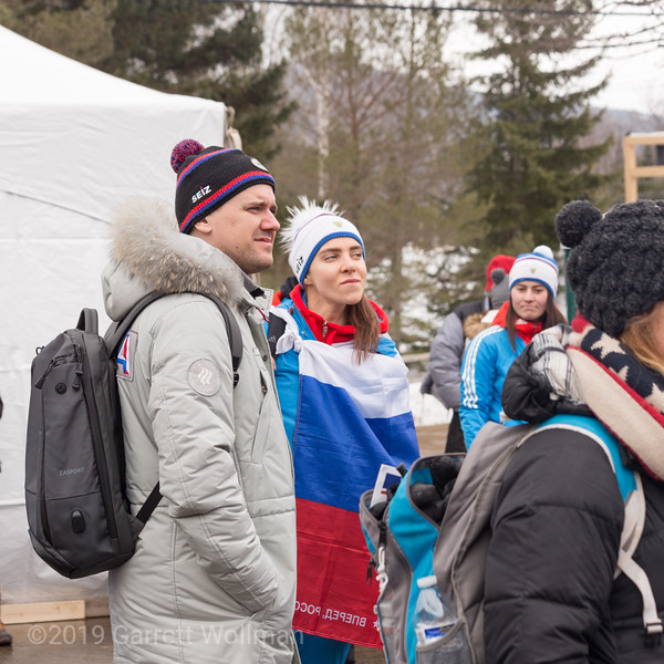 Spectators and athletes waiting for the medal ceremony