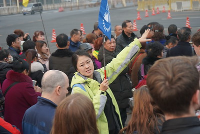 Worldstrides tour guide takes students on a trip to Tiananmen square.