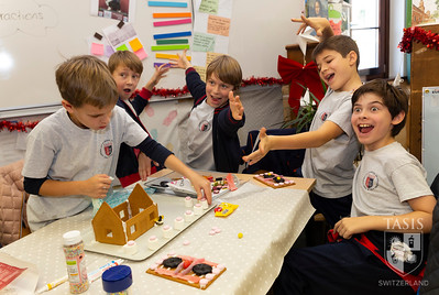 5th Grade students build gingerbread houses.