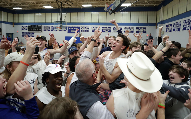 PHOTO/ANDREW SHURTLEFF Blue Ridge School fans celebrate the win over the Miller School Wednesday night at the Blue Ridge School.