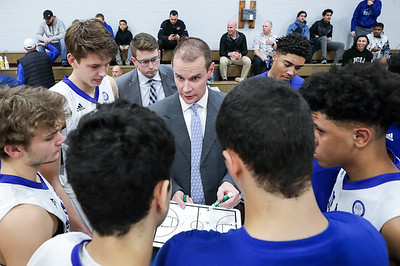 PHOTO/ANDREW SHURTLEFF  Blue Ridge School's head coach Cade Lemcke talks with his team during the game Wednesday night at the Blue Ridge School.