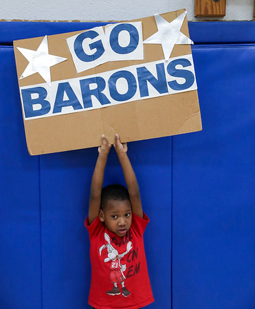 ANDREWPHOTO/ANDREW SHURTLEFF A Blue Ridge School fans holds up a sign during the game Wednesday night at the Blue Ridge School.