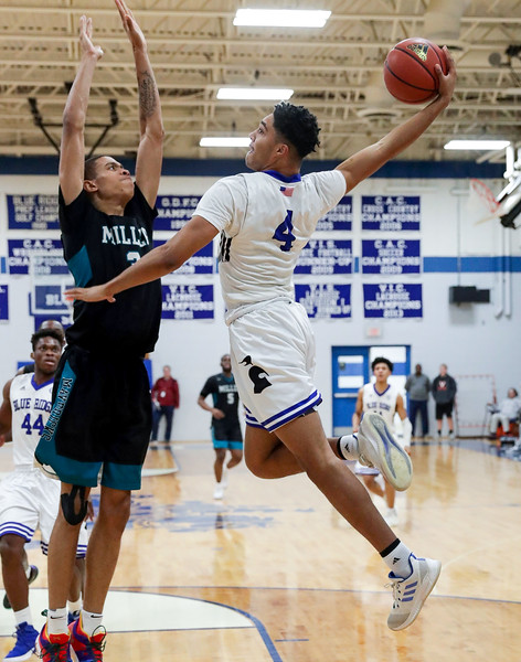 PHOTO/ANDREW SHURTLEFF Blue Ridge School's forward Savion Helm (4) attempts a dunk next to Miller School's Daryl Anderson (3) during the game Wednesday night at the Blue Ridge School.
