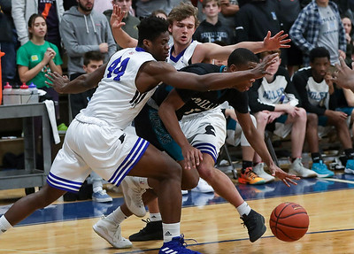 PHOTO/ANDREW SHURTLEFF Blue Ridge School's forward Andrew Nwaoko (44) and Blue Ridge School's guard Chris Rogers (0) puts pressure on Miller School's Quadir Pettaway (1) during the game Wednesday night at the Blue Ridge School.