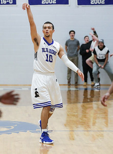 PHOTO/ANDREW SHURTLEFF Blue Ridge School's guard Ernesto Torres (10) celebrates a 3-pint basket during the game Wednesday night at the Blue Ridge School.
