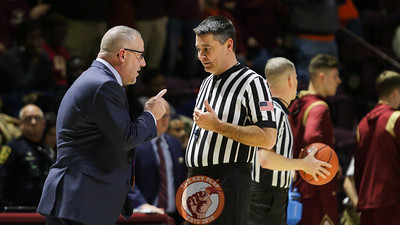 Head coach Buzz Williams speaks with referee Pat Driscoll during a break in the action. (Mark Umansky/TheKeyPlay.com)