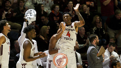 Nickeil Alexander-Walker celebrates on the bench after a Virginia Tech three point shot in the second half. (Mark Umansky/TheKeyPlay.com)