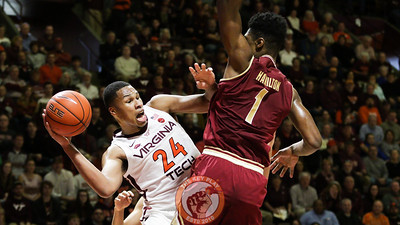 Kerry Blackshear Jr. turns back to pass the ball outside undeneath the Boston College basket in the second half. (Mark Umansky/TheKeyPlay.com)