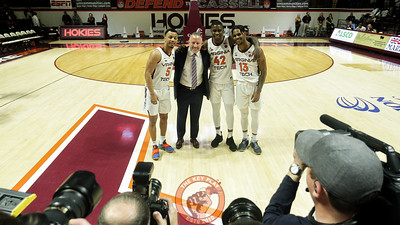 Head coach Buzz Williams poses with seniors Justin Robinson, Ty Outlaw, and Ahmed Hill at the end of senior day ceremonies. (Mark Umansky/TheKeyPlay.com)