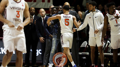 Senior Justin Robinson is subbed off after an honorary start in the last home game of the season while still recovering from a foot injury. (Mark Umansky/TheKeyPlay.com)