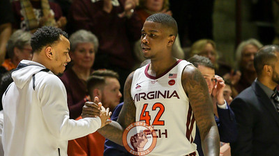 Ty Outlaw is congratulated by Justin Robinson as he's subbed off for the last time in Cassell. (Mark Umansky/TheKeyPlay.com)