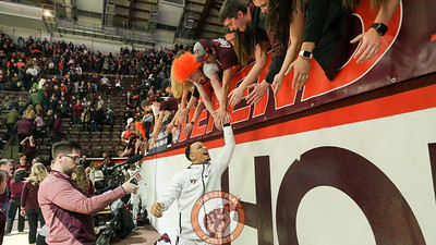 Senior Justin Robinson high fives the student section as the Hokies celebrate a regular season ending home win over Miami. (Mark Umansky/TheKeyPlay.com)