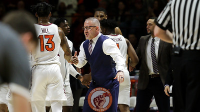 Head coach Buzz Williams high fives Ahmed hill after Miami called a timeout following a Hokie scoring run. (Mark Umansky/TheKeyPlay.com)