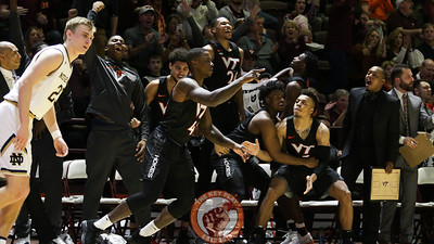 The Hokies bench continues to celebrate after Ty Outlaw's three point shot in the second half. (Mark Umansky/TheKeyPlay.com)