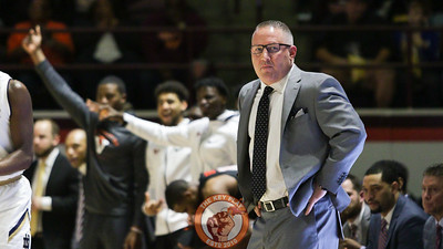 Hokies head coach Buzz Williams watches play from the other side of the court in the first half. (Mark Umansky/TheKeyPlay.com)