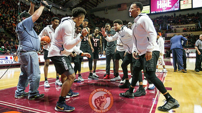 The Hokies play some imaginary dice before the national anthem and opening tip. (Mark Umansky/TheKeyPlay.com)