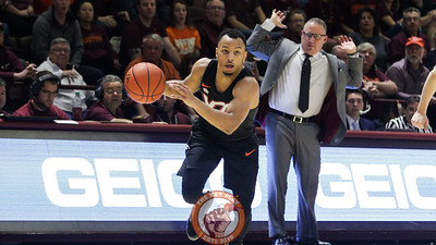 Justin Robinson collects a loose ball as head coach Buzz Williams throws up his hands to stay out of the way along the sideline in the second half. (Mark Umansky/TheKeyPlay.com)