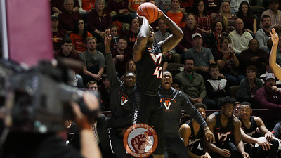 Ty Outlaw prepares to shoot a three point shot while the Virginia Tech bench behind him has already started to celebrate before the attempt. (Mark Umansky/TheKeyPlay.com)