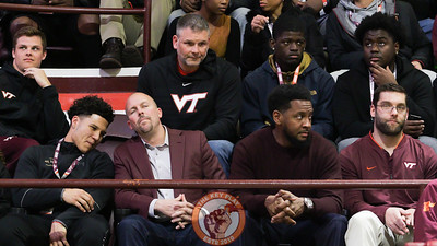 Virginia Tech head football coach Justin Fuente and assistants Brad Cornelson and Zohn Burden sit with recruits during the first half. (Mark Umansky/TheKeyPlay.com)