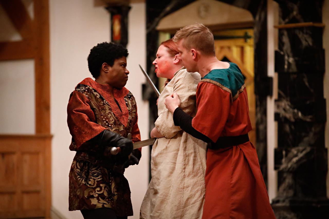 Shunté Lofton as Sir Piers Exton, Sarah Fallon as Richard II, and Benjamin Reed as Servant in RICHARD II.  Photo by Lindsey Walters.
