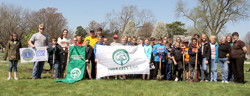 Members of the Altamont City Tree Board, Altamont Garden Club, Altamont High School FFA Chapter, the Altamont Lions Club and fifth grade students from Altamont Grade School pose after planting three trees in the Union Cemetery on Friday, which was Arbor Day. Graham Milldrum photo