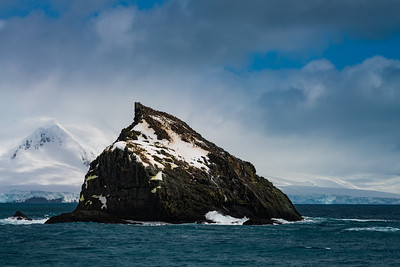 Penguin-covered rock near Point Wild, Elephant Island