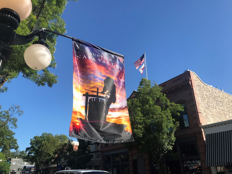 Flags flying High over Main Street in St. Helena welcoming in Auction Napa Valley 2018.  Photo by Tony Albright for Napa Valley Vintners