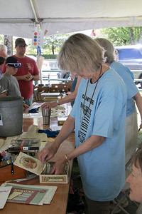 09-Volunteer_Mary_Costello_counts_change_for_a_customer