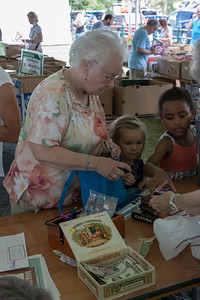 13-Jeanne_Fallon_her_granddaughter_Teagan_and_great-granddaughter_Zyairei_pay_for_their_new_books