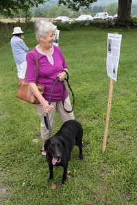 1-Shirley_Mosczynski_reads_one_of_the_signs_along_a_trail_describing_the_farms_history